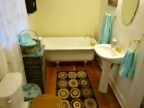 Master Bathroom has clawfoot tub and wood floors