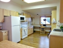 Large, open kitchen with with newer cabinets and appliances