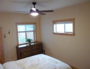 Master bedroom with Woven Poplar floors and lots of light