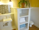 Master bath has linen storage and wainscoting