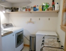 Laundry room is good-sized with lots of light