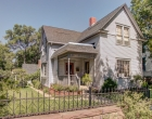 Front of home with original wrought iron fence
