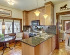 Kitchen with gas and solid surface countertops