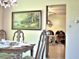 Dining room opens to good-sized kitchen