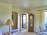 Archway opens from entry to living room