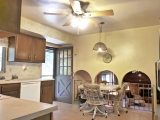 Kitchen opens to downstairs family room and backyard