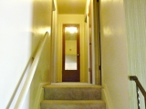 Stairs to upper level from entry way
