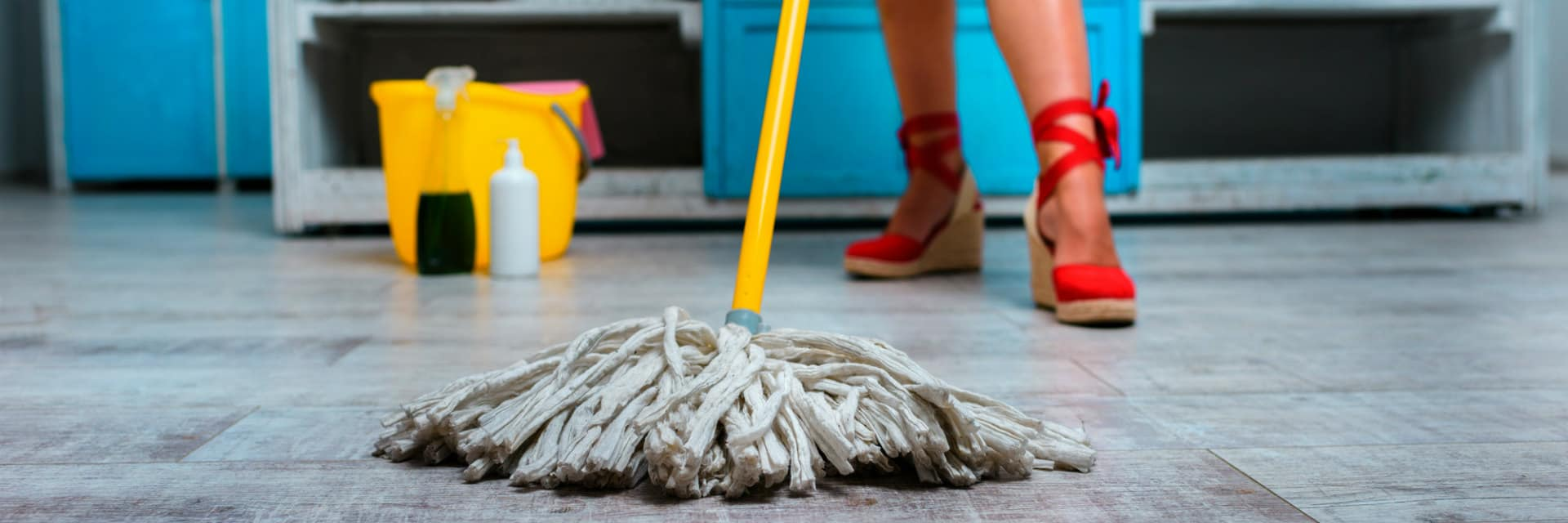 woman mopping kitchen floor in heels