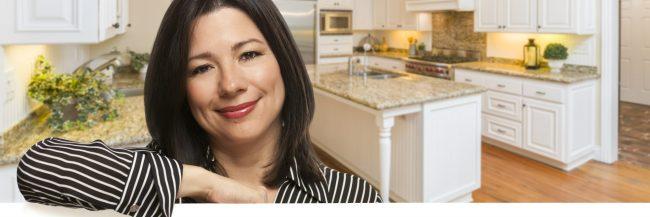 Hispanic Woman Leaning Against White Board In Custom Kitchen Interior.