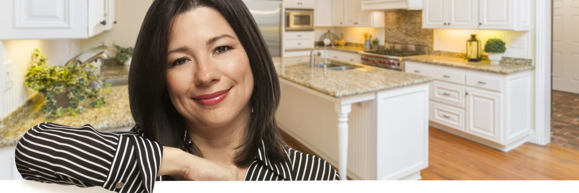 Hispanic Woman Leaning Against White Board In Custom Kitchen Interior.