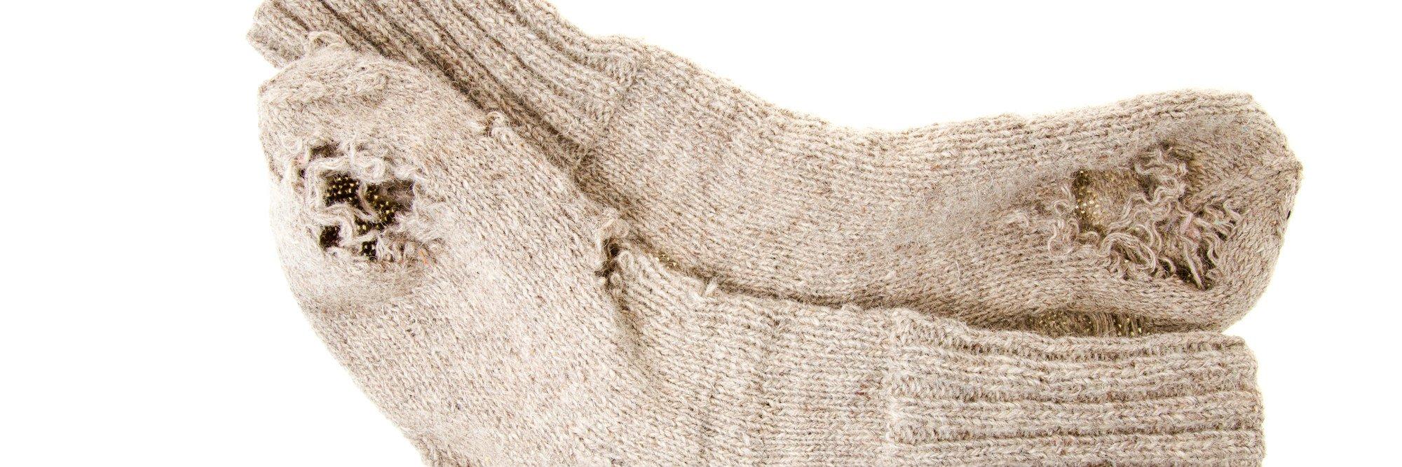 moth eaten woolen socks