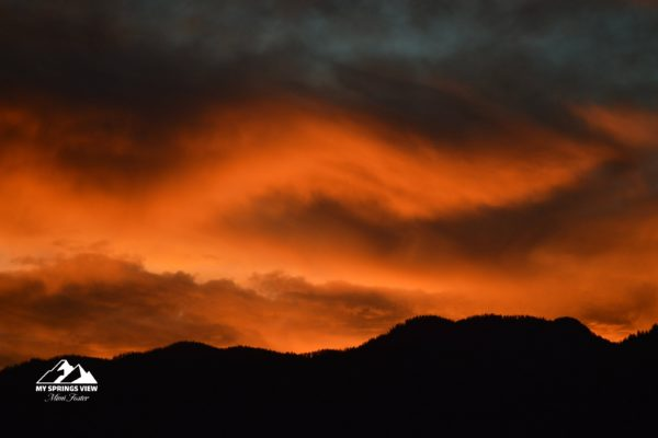 Red Clouds from Setting Sun behind the Foothills of the Rocky Mountains