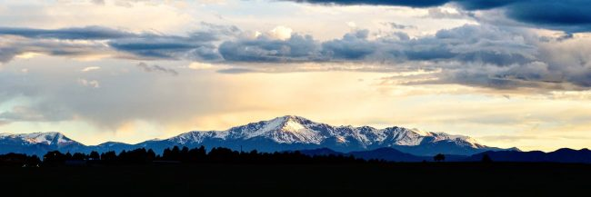 Pikes Peak in the distance at sunset