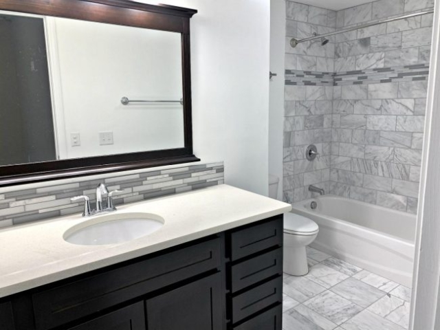Master bathroom on lower level with marble floors and surround