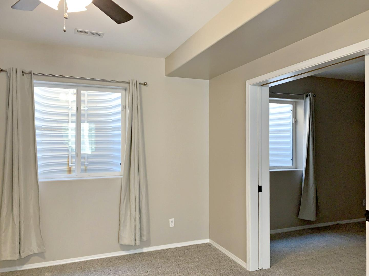 Family room toward bedroom with pocket doors