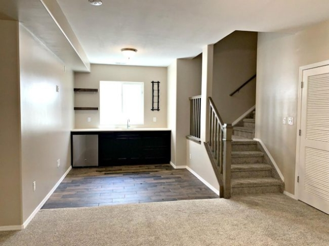 Family room toward wet bar and stairs