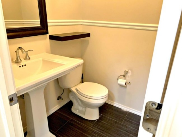Powder room next to kitchen and office