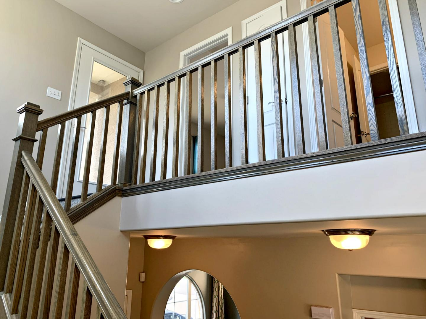 Open concept stair rail from first landing