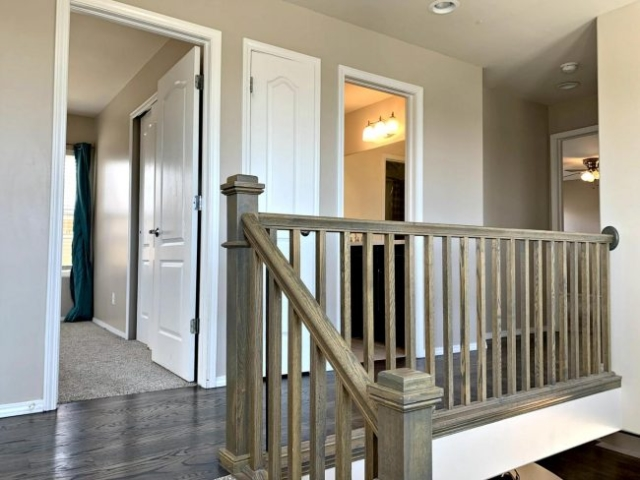 Wooden handrail toward bedroom, bath, and master
