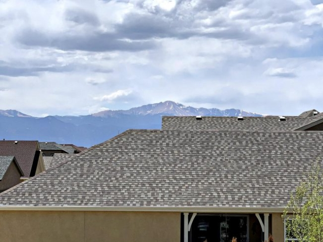 Pikes Peak view over rooflines from upper balcony