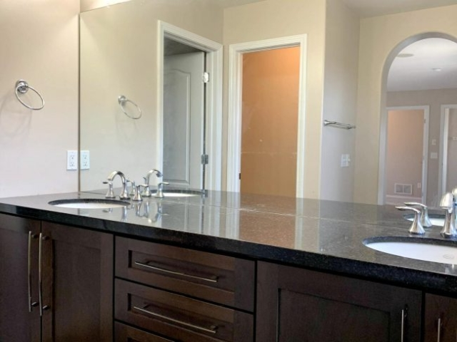 Solid surface countertop in master bath with double sink