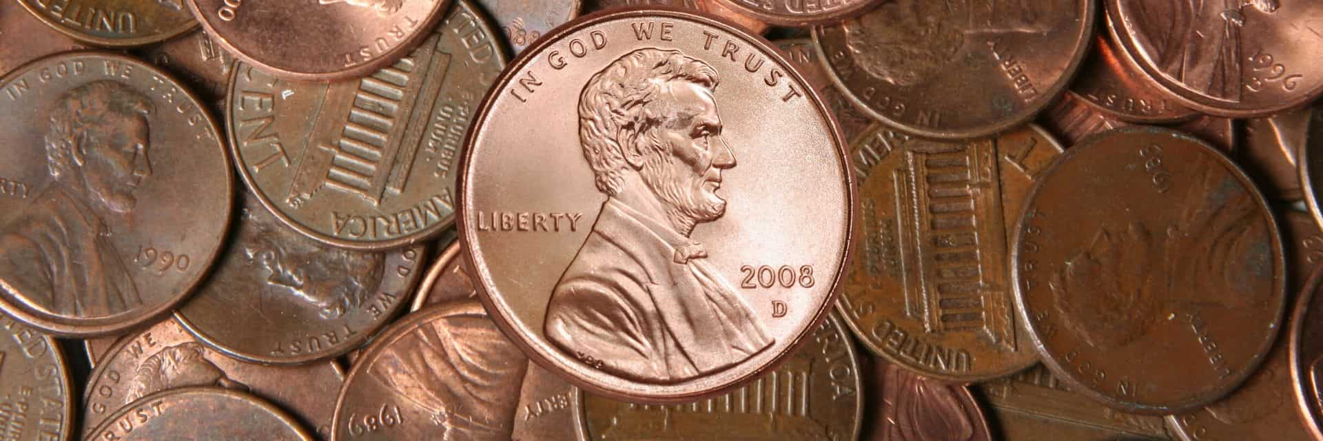 shiny penny on pile of dull pennies