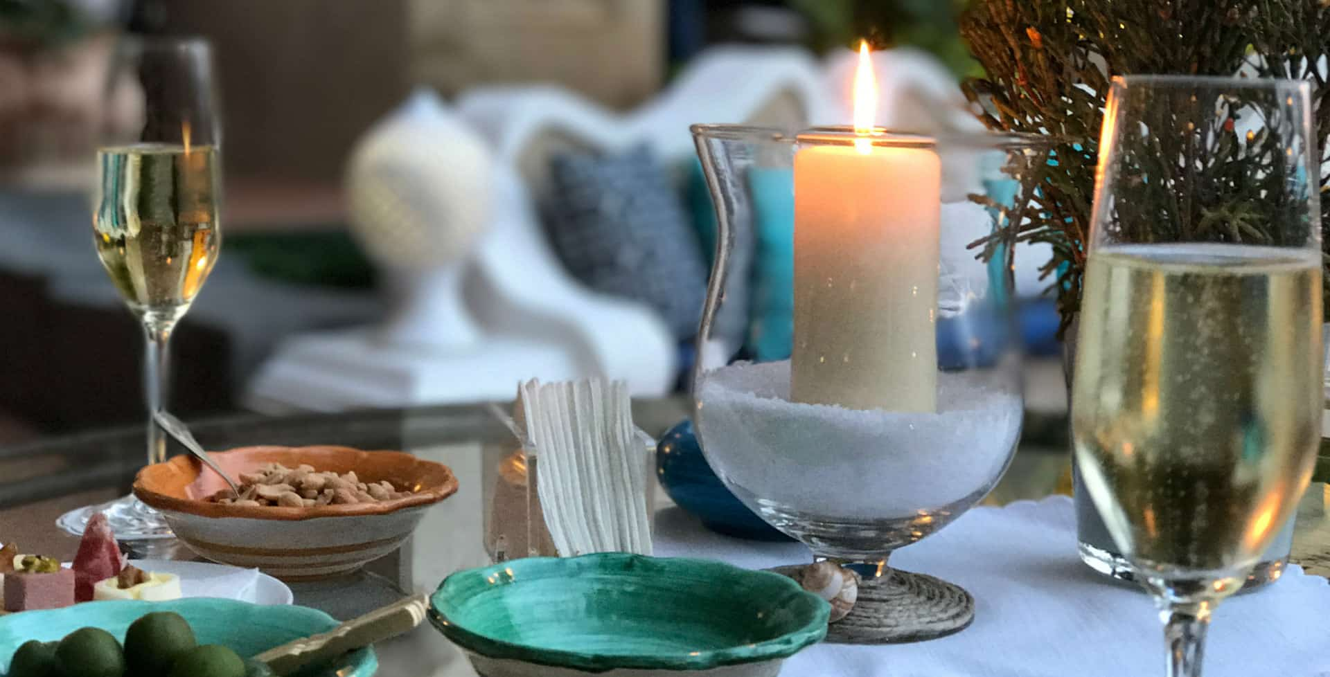 candle burning peaceful table setting