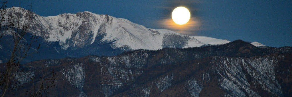 colorado springs housing market trends moon setting behind pikes peak