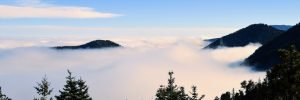 mountain peaks above the clouds altitude sickness