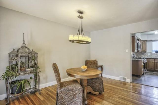 Dining room with oak floors looking toward kitchen