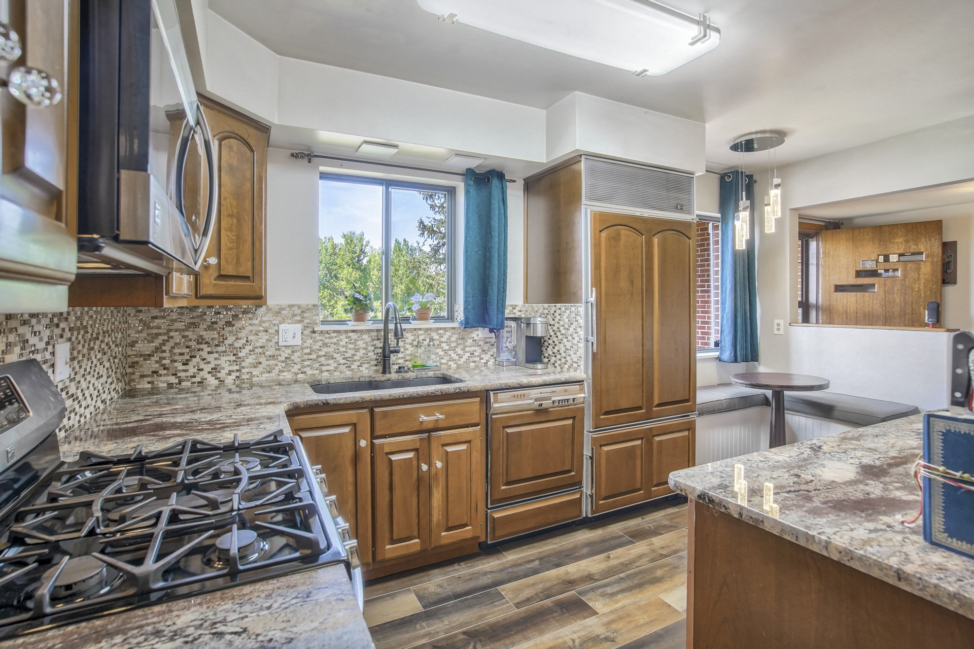 Gas stove and cherry cabinets in kitchen