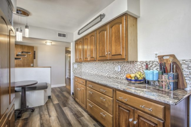 Cherry cabinets and granite countertops in kitchen