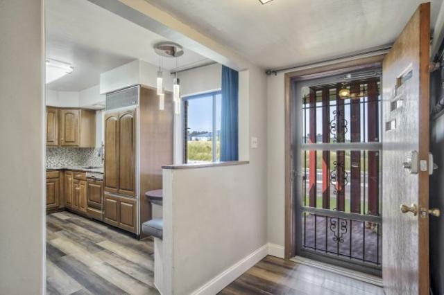 Open front door looking into kitchen