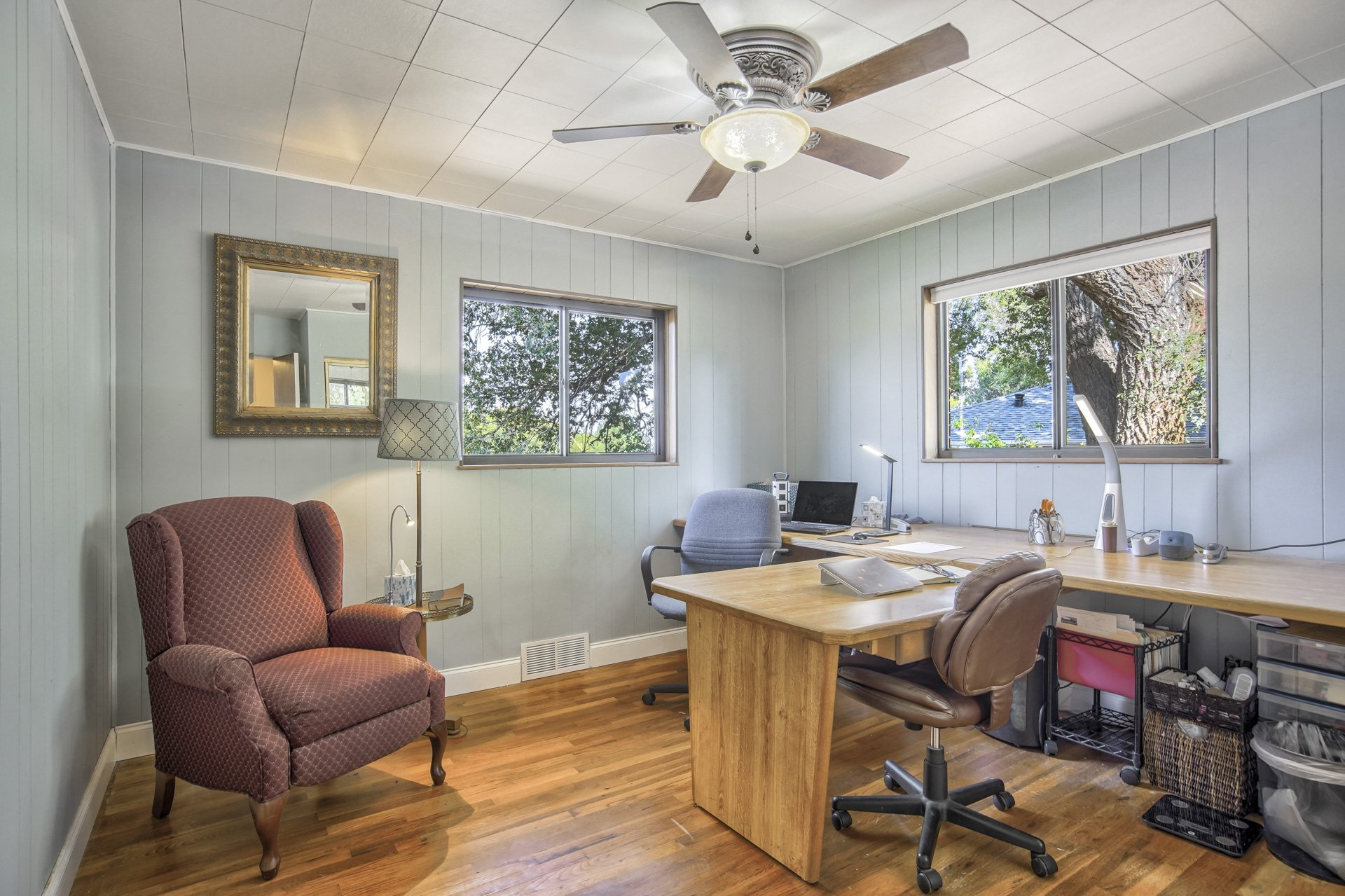 Desk and comfortable chair in office