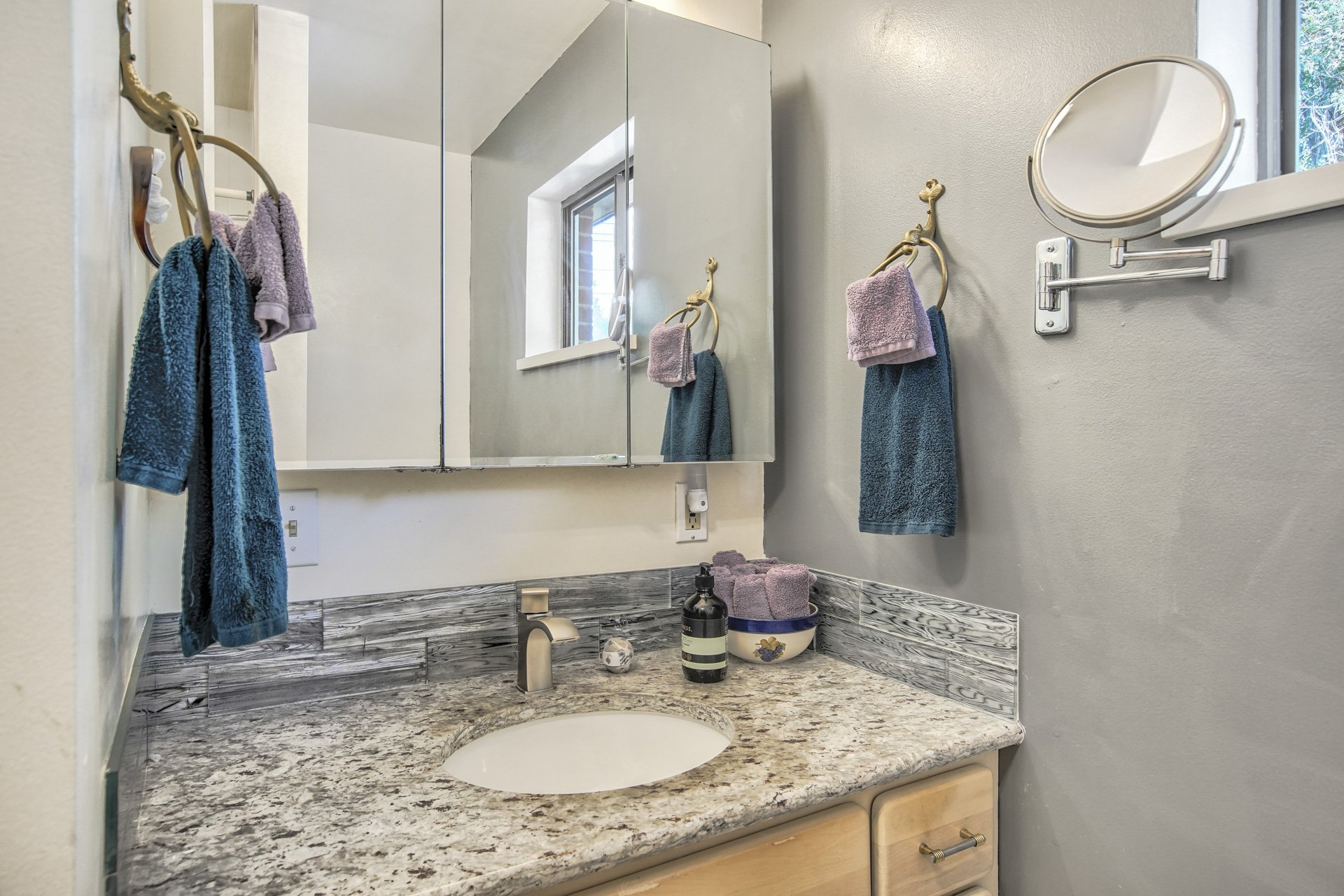 sink in granite counter with mirror