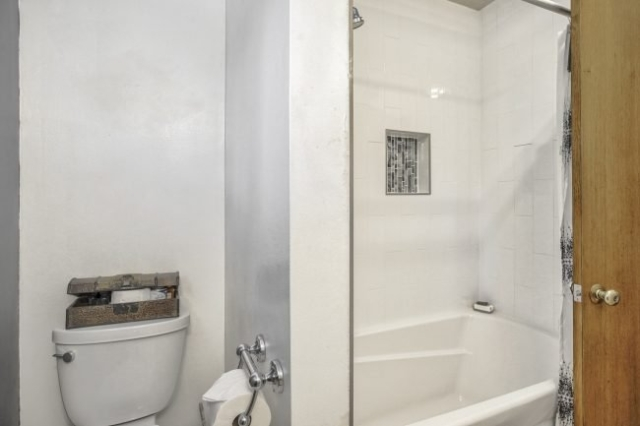 large soaking tub with tile surround