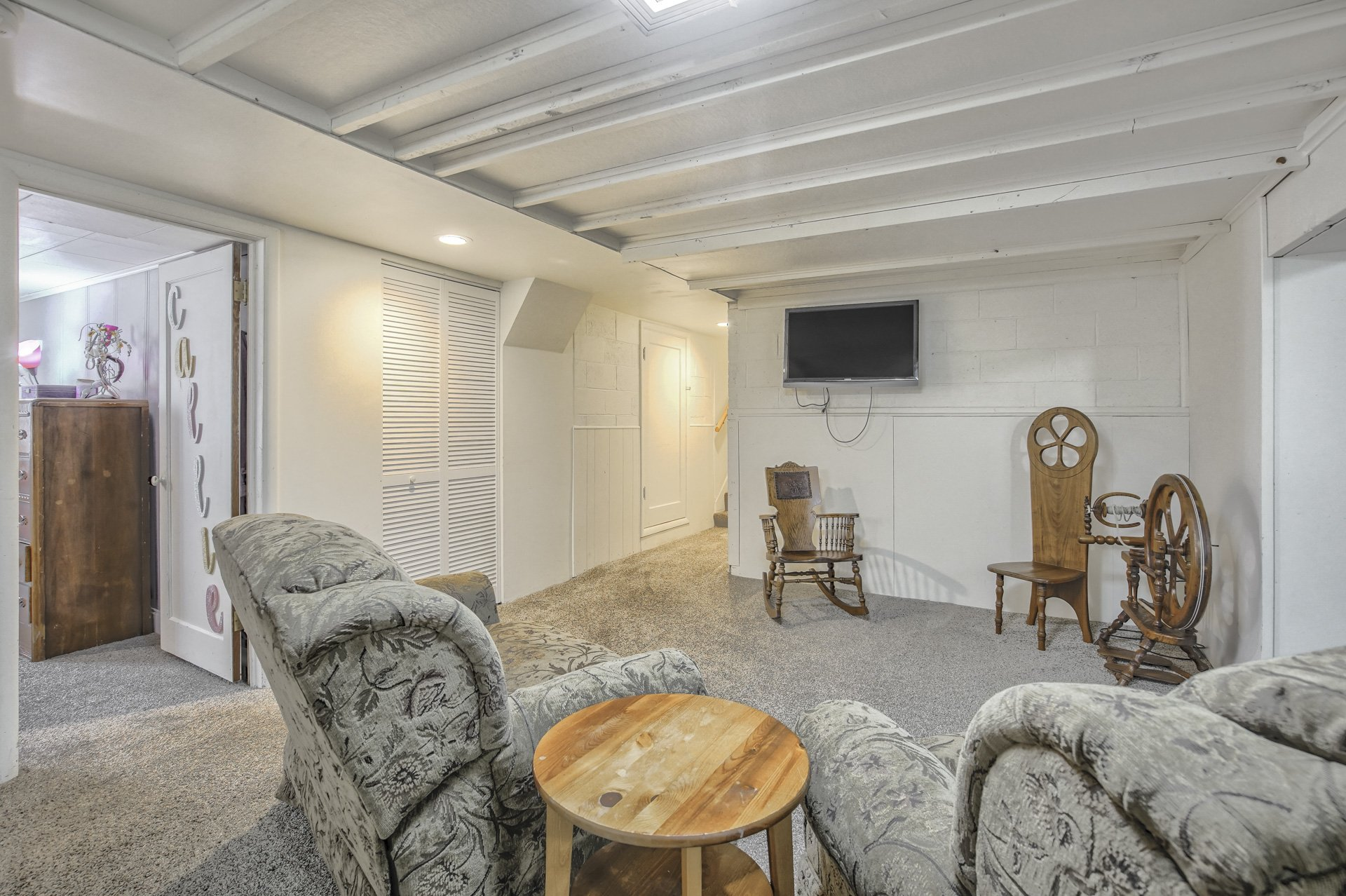 furniture and tv in basement