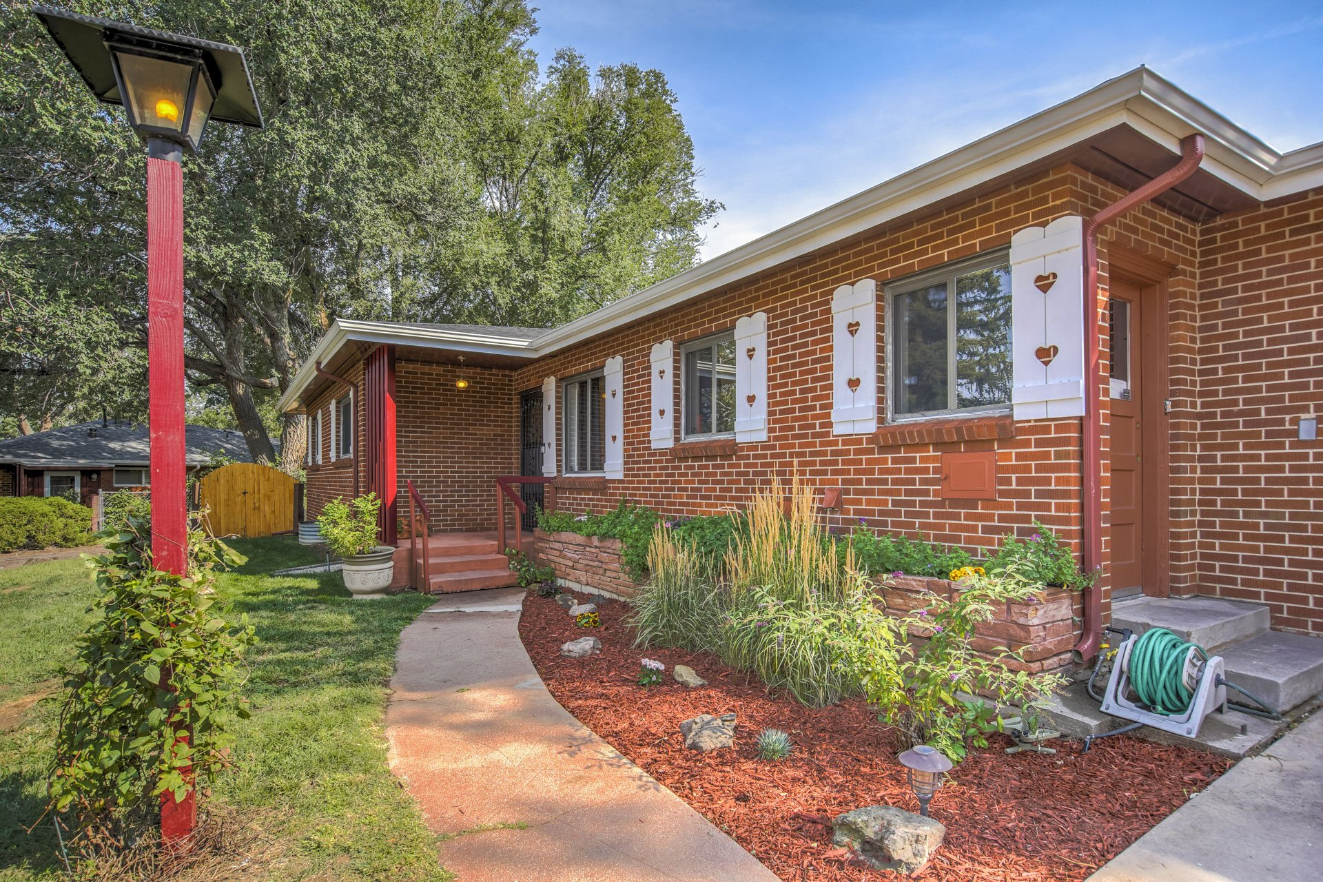 Garden and brick in front of Colorado Springs home for sale