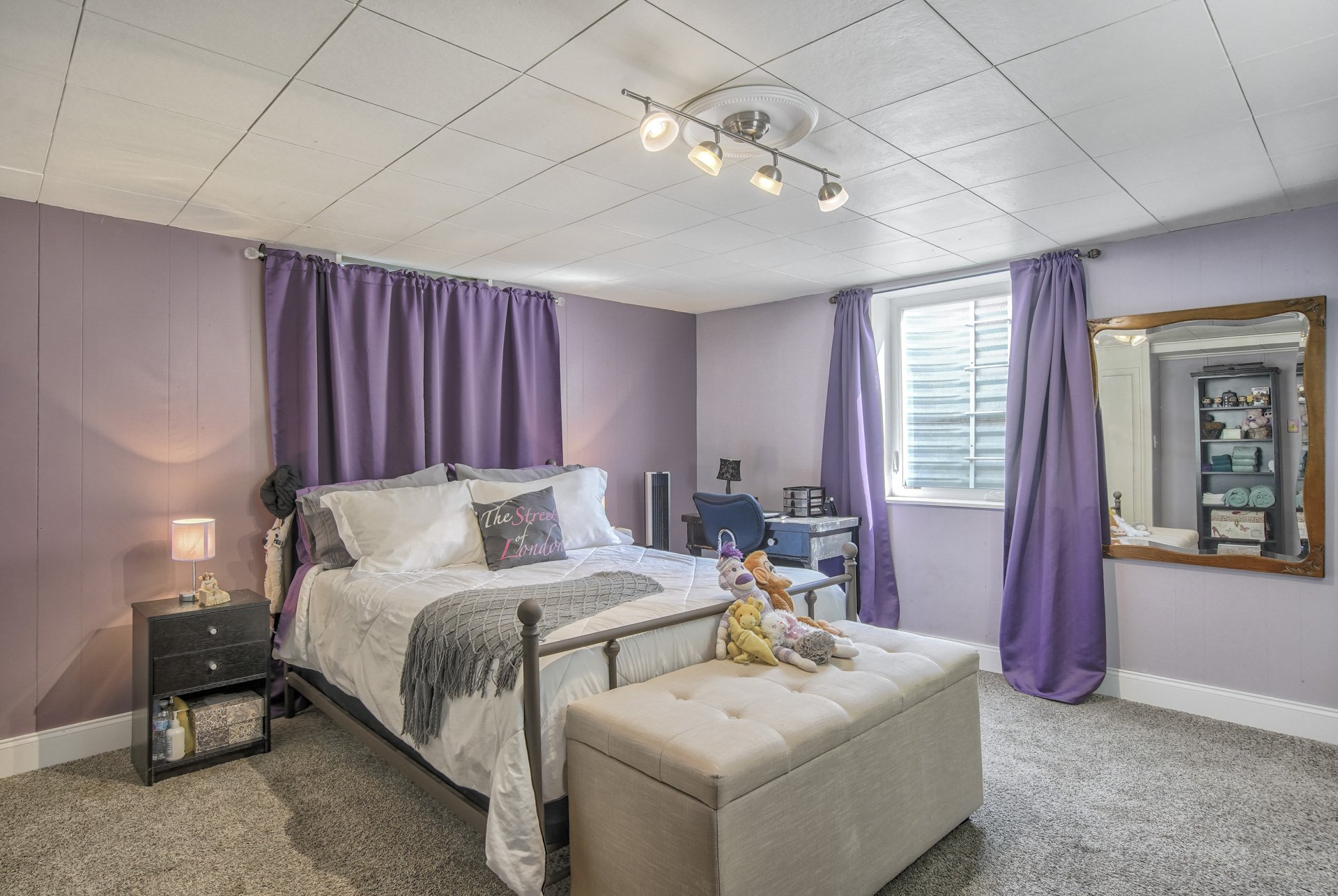 purple bedroom with bed