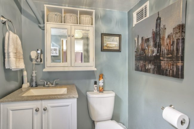 sink and toilet in blue bathroom