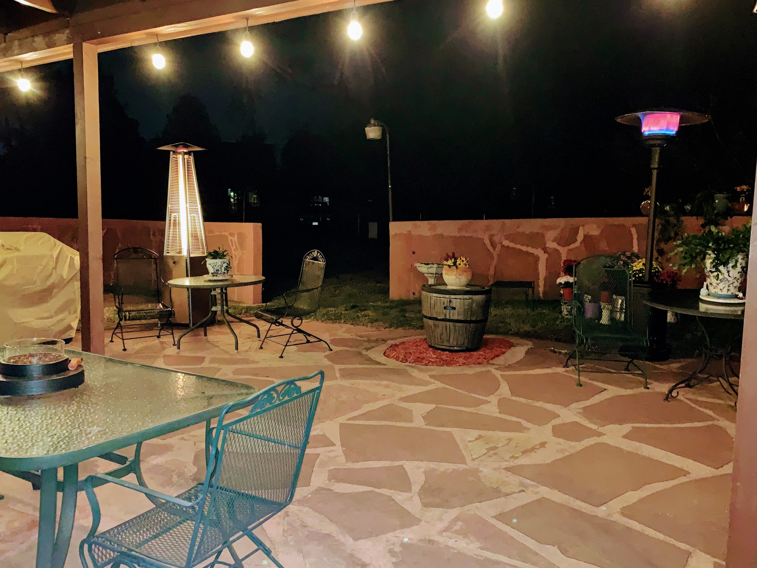 nighttime patio with heaters and lights