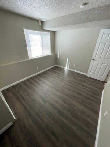 colorado springs fourplex for sale bedroom with new flooring