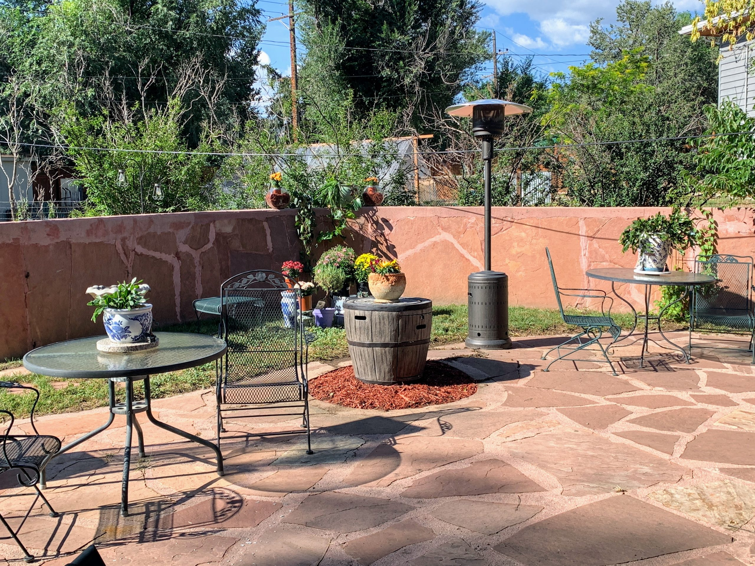 tables on patio with heater