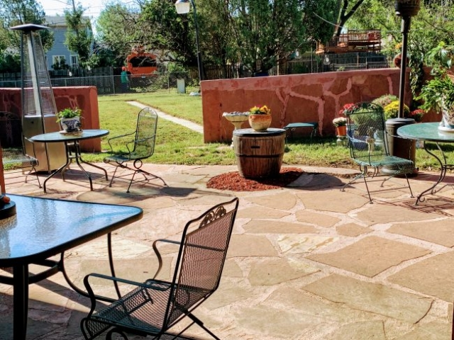 enclosed patio with large yard behind